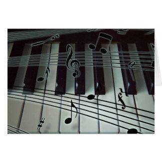 Llaves del piano y notas de la música tarjeta de felicitación