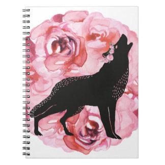 Lobo negro con el cuaderno rosado del blanco de