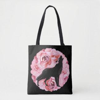 Lobo negro con la bolsa de asas rosada de los