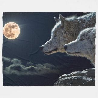 Lobos en la manta del paño grueso y suave del