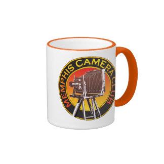 Logotipo anaranjado de la cámara de visión taza