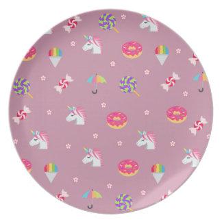 lollipops rosados lindos de las flores de los platos