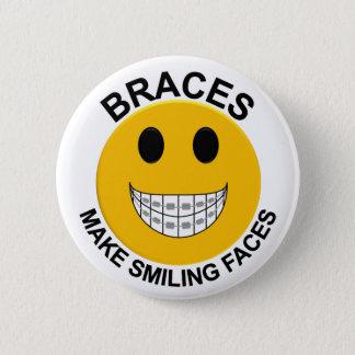 Los apoyos hacen el botón sonriente/Pin de las