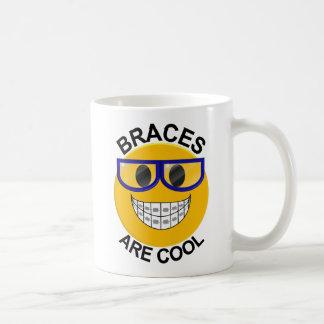 Los apoyos son taza de café fresca del dentista
