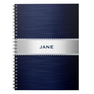 los azules marinos metal con los diamantes y cuaderno