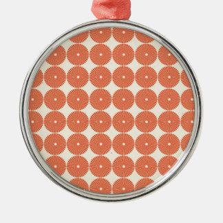 Los círculos anaranjados bonitos del melón adorno redondo plateado