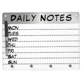 Los días diarios de las notas de la semana secan pizarra blanca con ganchos para llaves