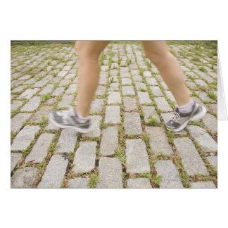 Los E.E.U.U., New York City, piernas borrosas de l Tarjetón