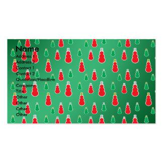 Los muñecos de nieve verdes rojos en verde se tarjetas de visita
