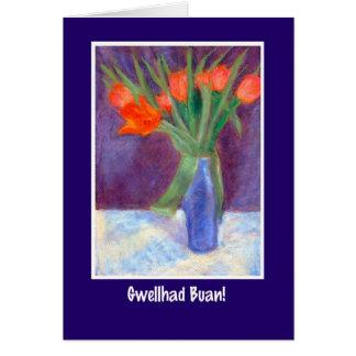 Los tulipanes rojos consiguen la tarjeta bien,