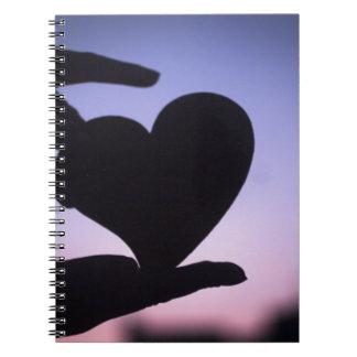 Love heart shape in hands photograph romantic vale libros de apuntes con espiral