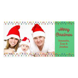 Luces del día de fiesta de las Felices Navidad con Tarjeta