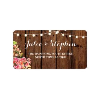 Luces florales que casan la madera de la etiqueta