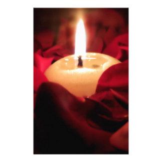 Luz de una vela y rosas papeleria