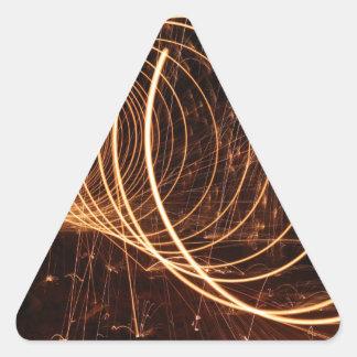 Luz que remolina pegatina triangular