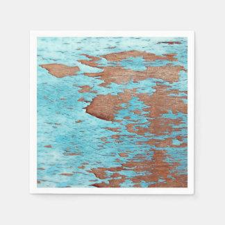Madera con la peladura de la pintura azul servilleta de papel