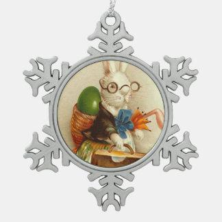 Maleta coloreada del huevo del conejito de pascua  adorno de peltre en forma de copo de nieve