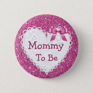 Mamá a ser botón rosado de la fiesta de bienvenida
