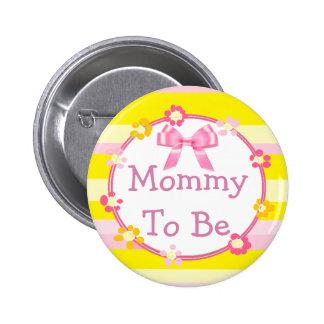 Mamá a ser botón rosado y amarillo de la fiesta de