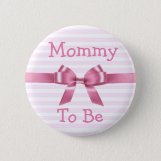 Mamá a ser botón rosado y blanco de la fiesta de