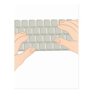Manos en el teclado postal