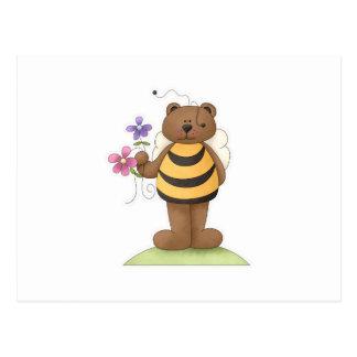 Manosee el oso con las flores postal