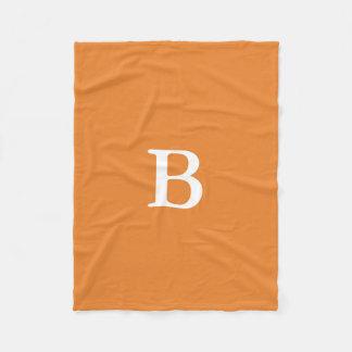 Manta de encargo del naranja del monograma