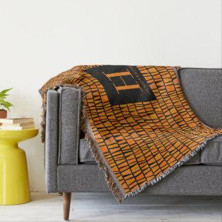 Manta Monograma anaranjado inspirado africano del modelo