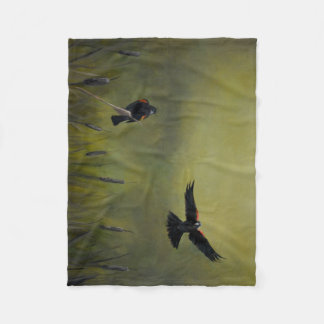 Manta negra de alas rojas de la reproducción del