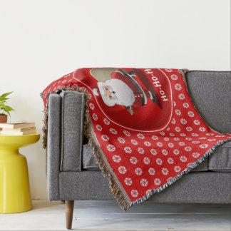 Manta Tejida Papá Noel divertido con un saco lleno de regalos