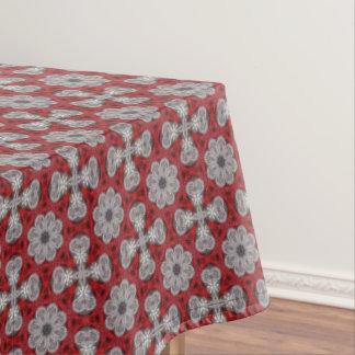 Mantel Flores y cruces grises en rojo texturizado