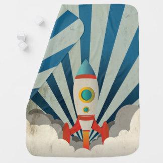 Mantita Para Bebé Rocket colorido con los rayos azules y el humo
