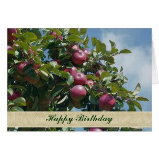 Manzanas en tarjeta de cumpleaños de la fotografía
