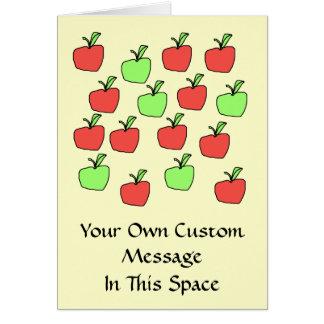 Manzanas rojas y manzanas verdes, modelo, en la tarjeta de felicitación