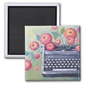 Máquina de escribir del vintage y imán de las
