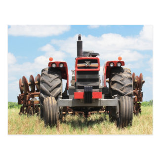 Marcha lenta que se sienta del tractor grande viej postales