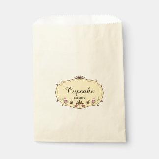 Marco de la panadería de la magdalena con las bolsa de papel