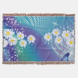 Margarita flor-en la manta azul del tiro del fondo