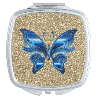Mariposa abstracta en brillo del oro espejos de maquillaje