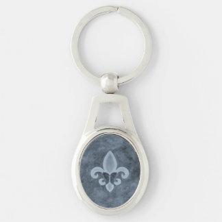Mariposa azul de la flor de lis del dril de llavero plateado ovalado