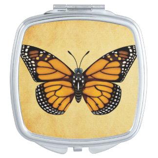 Mariposa de monarca espejos de viaje