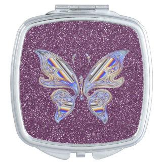Mariposa elegante abstracta en brillo púrpura espejos para el bolso