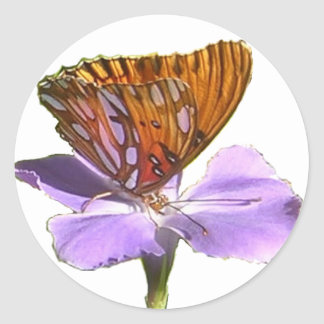 Mariposa y flor pegatina redonda