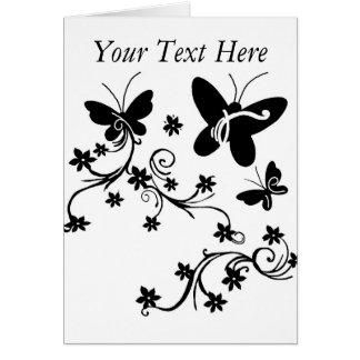 Mariposas con la tarjeta negra del blanco de las f