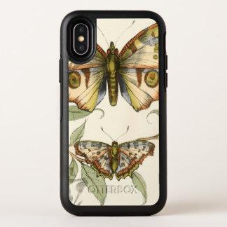 Mariposas en tándem sobre las hojas verdes