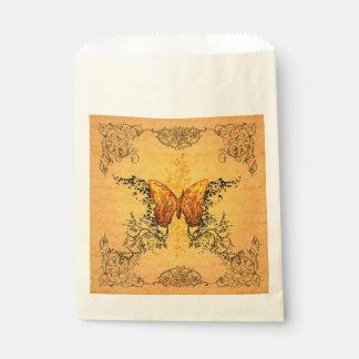 Mariposas maravillosas con los elementos florales bolsa de papel