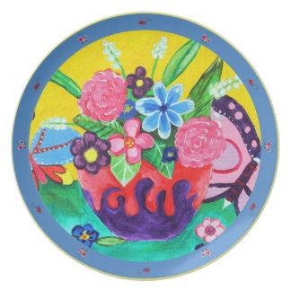 Mariposas y placa de las mariquitas plato de comida