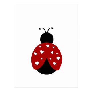 Mariquita negra y roja del corazón postal