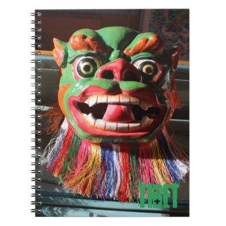 Máscara budista tibetana del festival cuadernos
