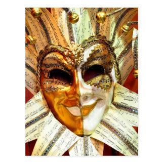 Máscara veneciana del bufón del carnaval con postal